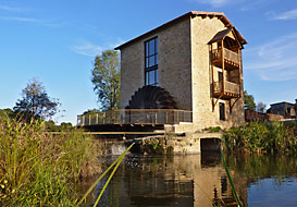 Riverside watermill in an idyllic location